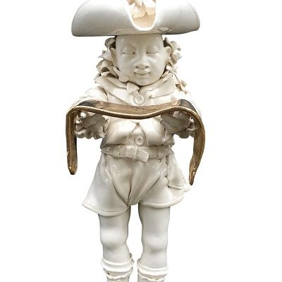 hatted-lad About 550mm tall Hangs on a wall Earthenware and gold lustre